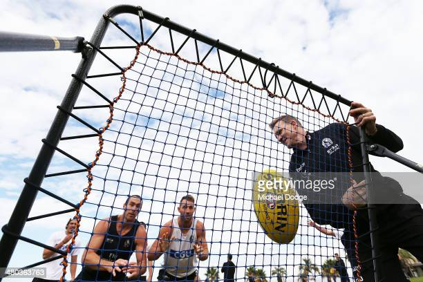 Ben Hudson and Travis Cloke contest for the ball thrown by coach Nathan Buckley during a Collingwood Magpies AFL recovery session at St Kilda Sea...