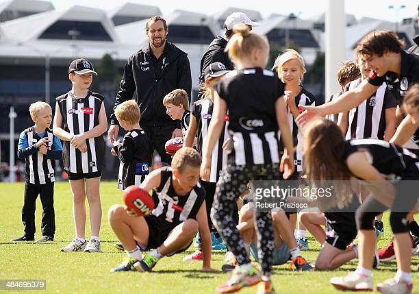 Ben Hudson looks on during a Collingwood Magpies School Holiday AFL clinic at Olympic Park on April 14 2014 in Melbourne Australia