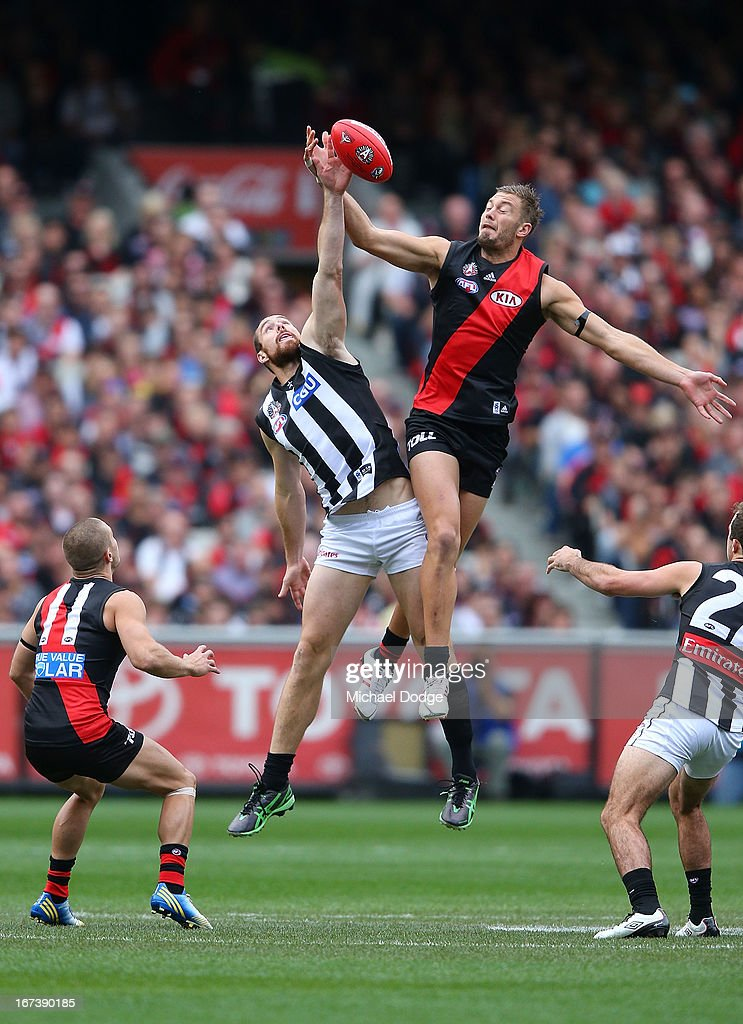 Ben Hudson of the Magpies (L) and Tom Bellchambers of the Bombers contest for the ball during the round five AFL match between the Essendon Bombers and the Collingwood Magpies at Melbourne Cricket Ground on April 25, 2013 in Melbourne, Australia.
