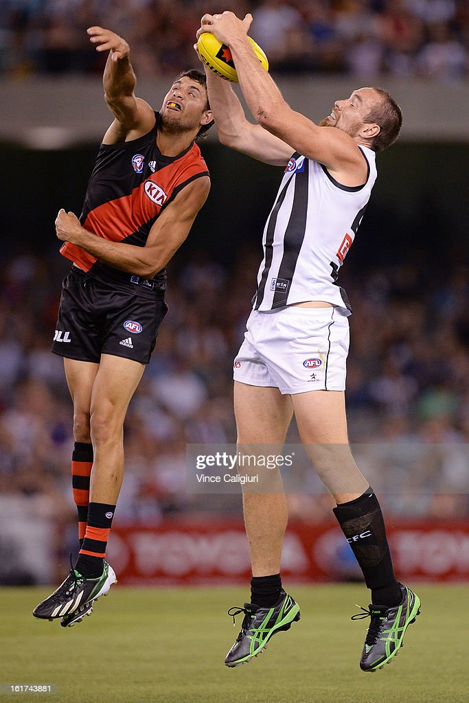 Ben Hudson of the magpies marks in front of Patrick Ryder of the bombers during the round one AFL NAB Cup match between the Collingwood Magpies and the Essendon Bombers at Etihad Stadium on February 15, 2013 in Melbourne, Australia.