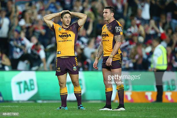 Ben Hunt and Darius Boyd of the Broncos look dejected after defeat during the round 24 NRL match between the Sydney Roosters and the Brisbane Broncos...