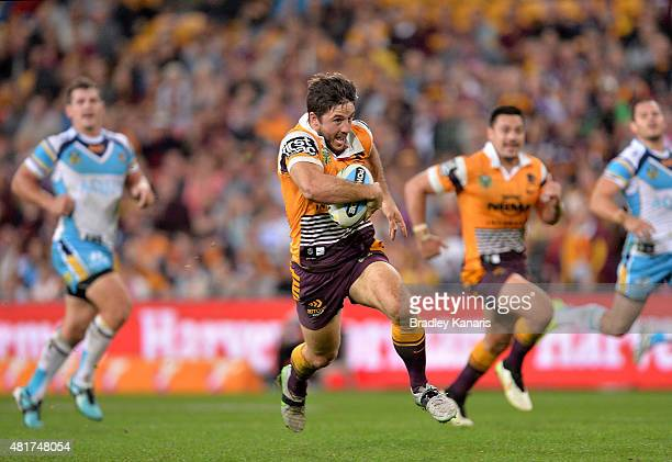 Ben Hunt of the Broncos breaks away from the defence during the round 20 NRL match between the Brisbane Broncos and the Gold Coast Titans at Suncorp...