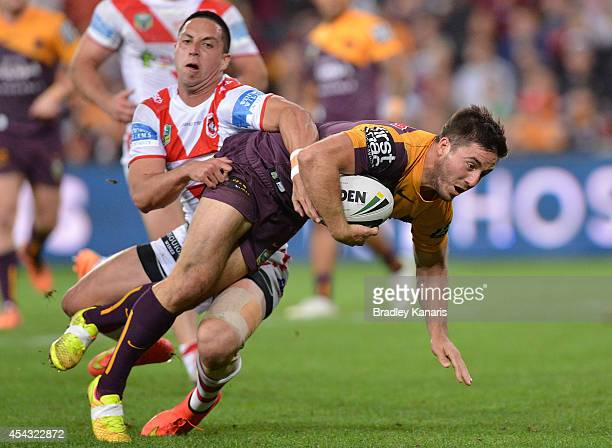 Ben Hunt of the Broncos breaks away from the tackle to score a try during the round 25 NRL match between the Brisbane Broncos and the St George...