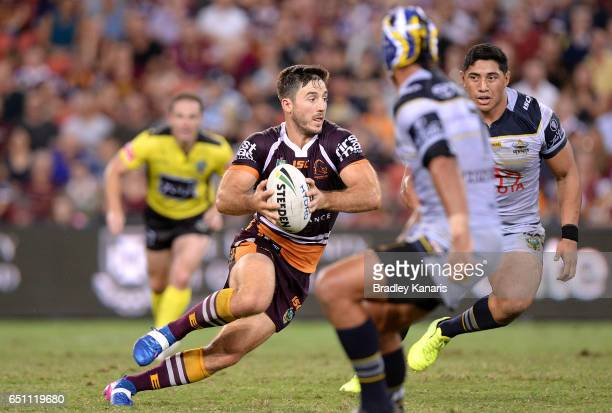 Ben Hunt of the Broncos breaks through the defence during the round two NRL match between the Brisbane Broncos and the North Queensland Cowboys at...
