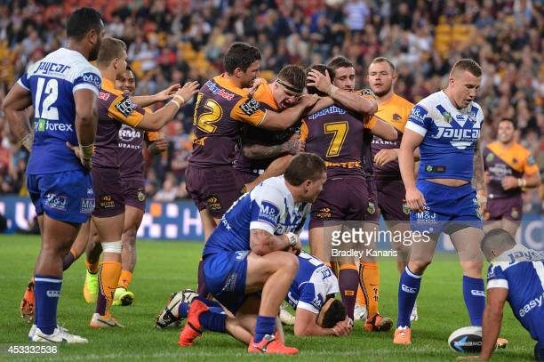 Ben Hunt of the Broncos celebrates after scoring a try during the round 22 NRL match between the Brisbane Broncos and the Canterbury Bulldogs at...