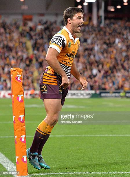 Ben Hunt of the Broncos celebrates scoring a try during the NRL First Preliminary Final match between the Brisbane Broncos and the Sydney Roosters at...