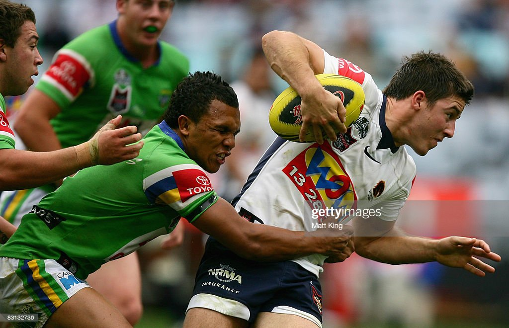 Ben Hunt of the Broncos is tackled during the Under 20's Toyota Cup Final match between the Canberra Raiders and the Brisbane Broncos at ANZ Stadium on October 5, 2008 in Sydney, Australia.