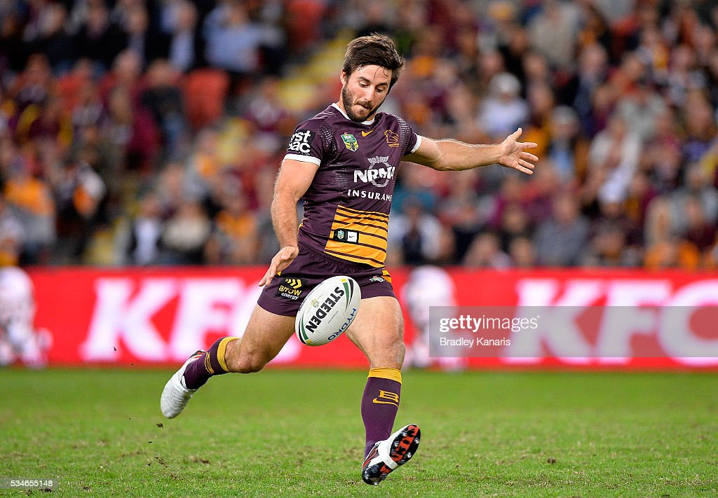 <a gi-track='captionPersonalityLinkClicked' href=/galleries/search?phrase=Ben+Hunt+-+Rugby+Player&family=editorial&specificpeople=13397153 ng-click='$event.stopPropagation()'>Ben Hunt</a> of the Broncos kicks the ball during the round 12 NRL match between the Brisbane Broncos and the Wests Tigers at Suncorp Stadium on May 27, 2016 in Brisbane, Australia.