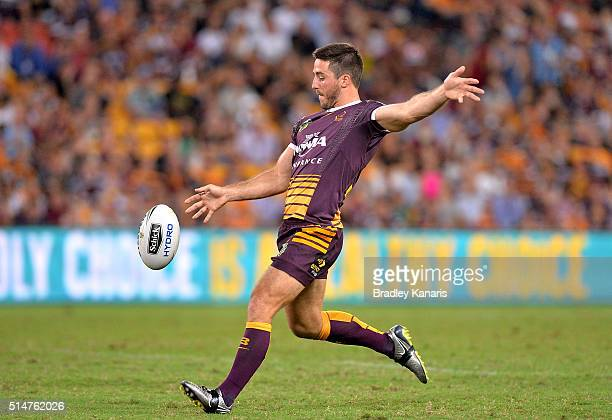 Ben Hunt of the Broncos kicks the ball during the round two NRL match between the Brisbane Broncos and the New Zealand Warriors at Suncorp Stadium on...