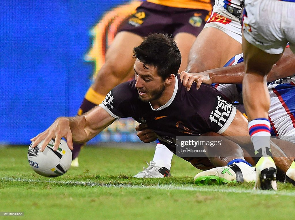 Ben Hunt of the Broncos scores a try during the round seven NRL match between the Brisbane Broncos and the Newcastle Knights at Suncorp Stadium on April 16, 2016 in Brisbane, Australia.