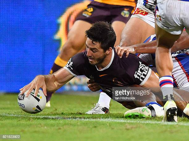 Ben Hunt of the Broncos scores a try during the round seven NRL match between the Brisbane Broncos and the Newcastle Knights at Suncorp Stadium on...