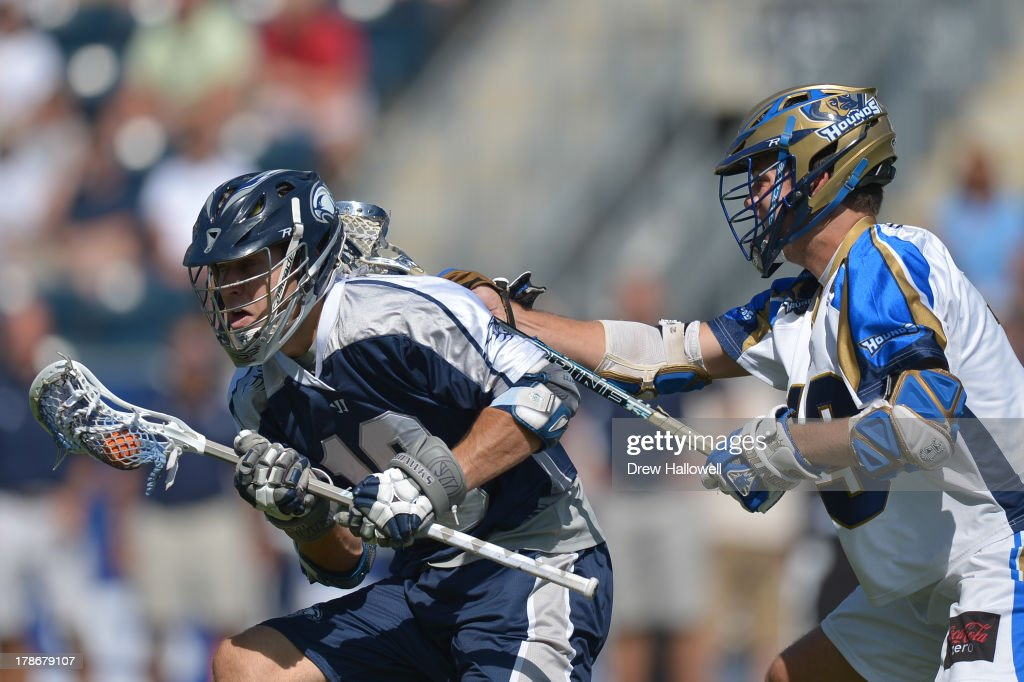 Ben Hunt #18 of the Chesapeake Bayhawks is checked by Kevin Drew #19 of the Charlotte Hounds during the MLL Championship at PPL Park on August 25, 2013 in Chester, Pennsylvania.