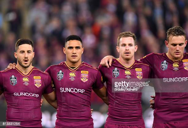 Ben Hunt Valentine Holmes Michael Morgan and Coen Hess of the Maroons embrace before game three of the State Of Origin series between the Queensland...