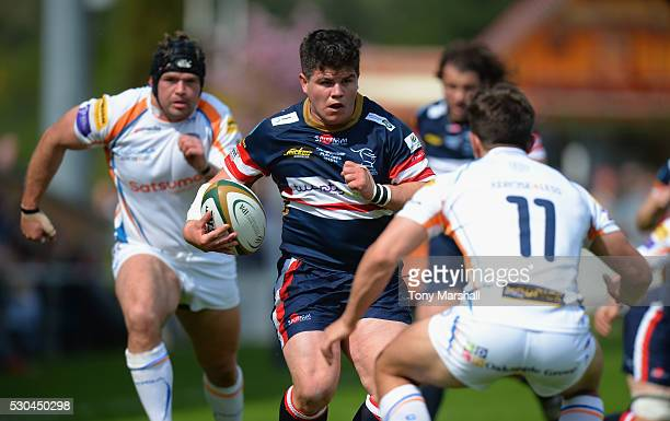 Ben Hunter of Doncaster Knights looks to get pastTaylor Prell of Yorkshire Carnegie during the Greene King IPA Championship Play Off Second Leg match...