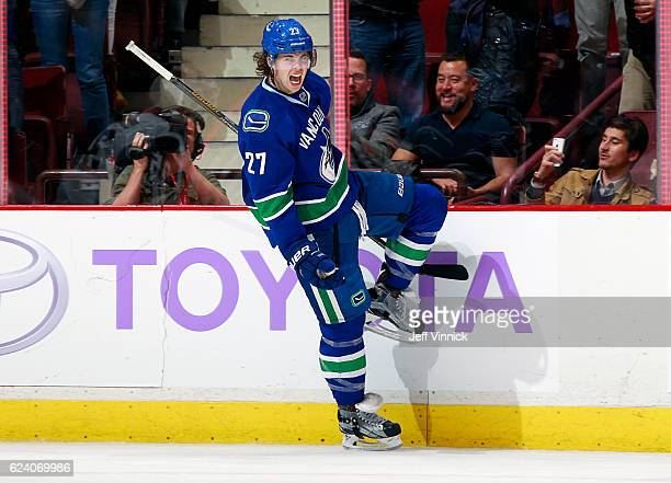 Ben Hutton of the Vancouver Canucks celebrates after scoring on an overtime penalty shot against the Arizona Coyotes during their NHL game at Rogers...