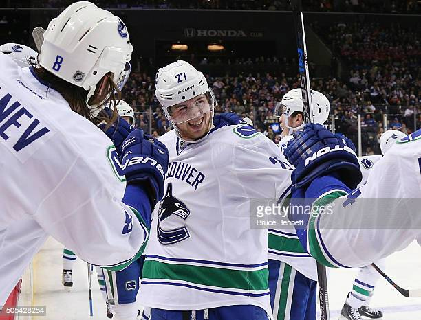 Ben Hutton of the Vancouver Canucks celebrates his first NHL goal against the New York Islanders at 946 of the second period at the Barclays Center...