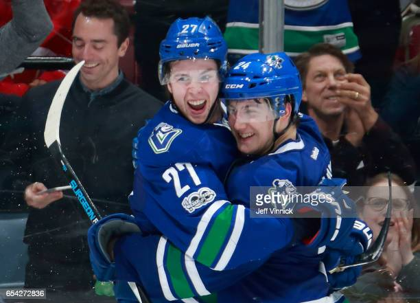 Ben Hutton of the Vancouver Canucks is congratulated by teammate Reid Boucher after scoring during their NHL game against the Dallas Stars at Rogers...