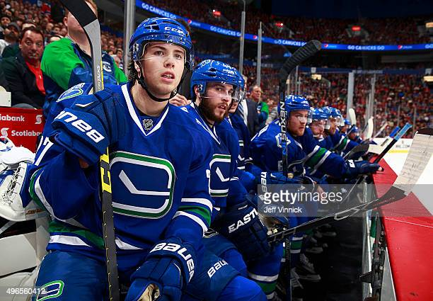 Ben Hutton of the Vancouver Canucks looks on from the bench during their NHL game against the Montreal Canadiens at Rogers Arena October 27 2015 in...