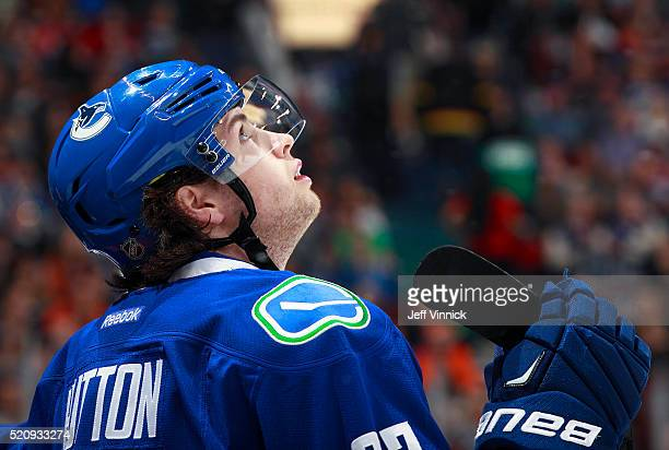 Ben Hutton of the Vancouver Canucks looks on from the bench during their NHL game against the Edmonton Oilers at Rogers Arena April 9 2016 in...