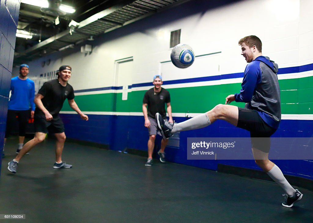 Ben Hutton #27 of the Vancouver Canucks plays soccer with teammates Jacob Markstrom #25, Markus Granlund #60 and Sven Baertschi #47 before their NHL game against the Calgary Flames at Rogers Arena January 6, 2017 in Vancouver, British Columbia, Canada.