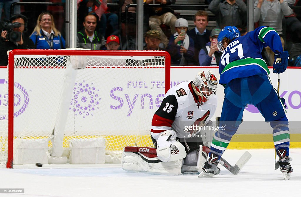 Ben Hutton #27 of the Vancouver Canucks scores on Louis Domingue #35 of the Arizona Coyotes on an overtime penalty shot during their NHL game at Rogers Arena November 17, 2016 in Vancouver, British Columbia, Canada. Vancouver won 3-2 in overtime.
