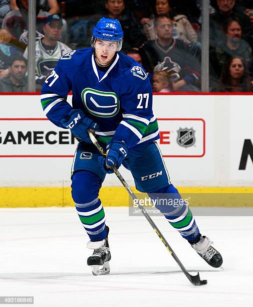 Ben Hutton of the Vancouver Canucks skates up ice with the puck during their NHL game against the St Louis Blues at Rogers Arena October 16 2015 in...