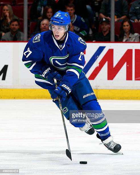 Ben Hutton of the Vancouver Canucks skates up ice with the puck during their NHL game against the Montreal Canadiens at Rogers Arena October 27 2015...