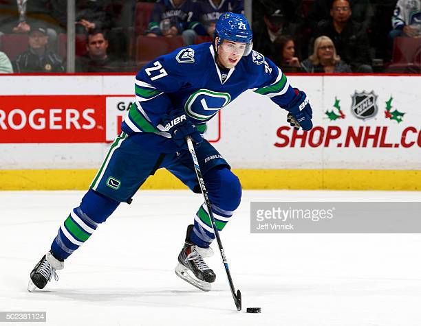 Ben Hutton of the Vancouver Canucks skates up ice with the puck during their NHL game against the New York Rangers at Rogers Arena December 9 2015 in...