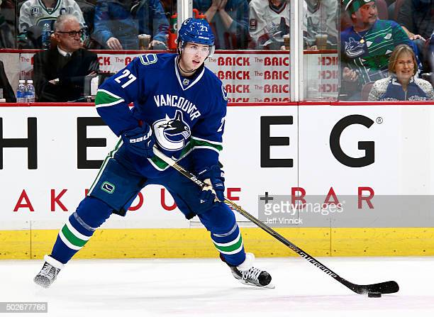 Ben Hutton of the Vancouver Canucks skates up ice with the puck during their NHL game against the Edmonton Oilers at Rogers Arena December 26 2015 in...