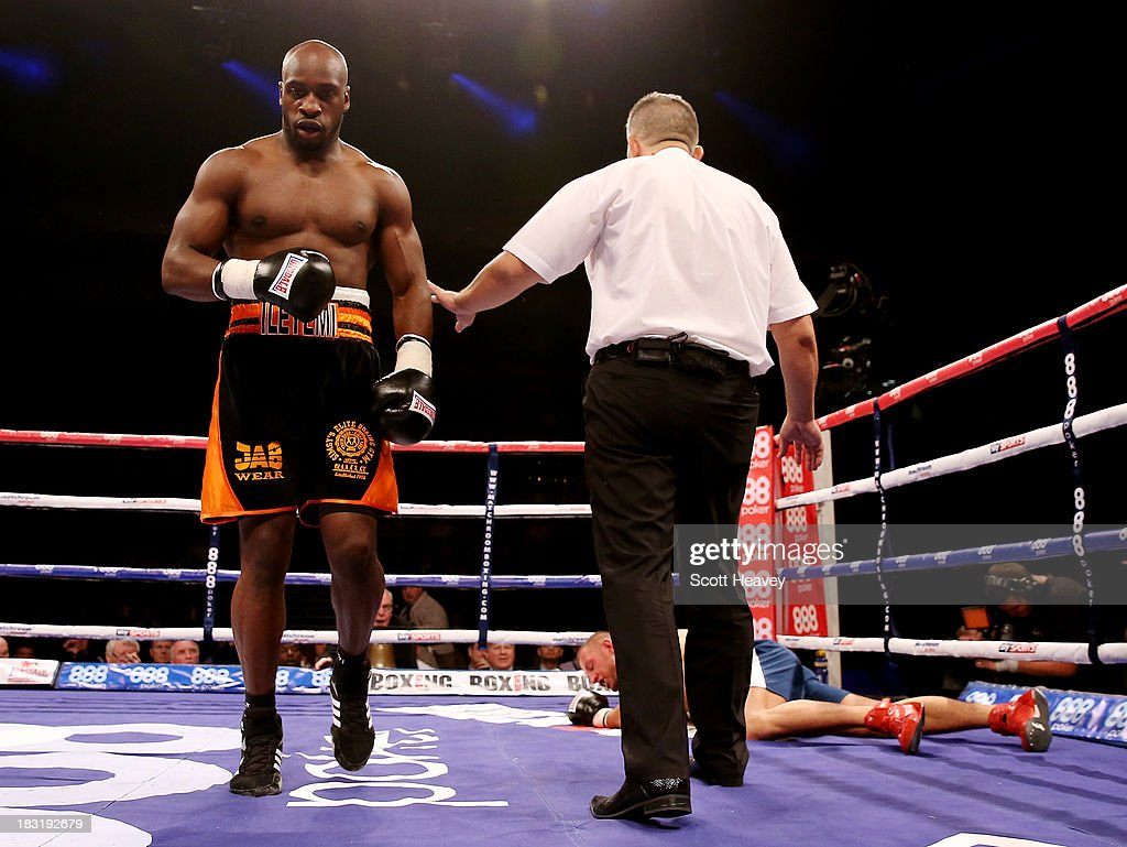 Ben Ileyemi knocks down Mark Reynolds during their Cruiserweight bout at O2 Arena on October 5, 2013 in London, England.