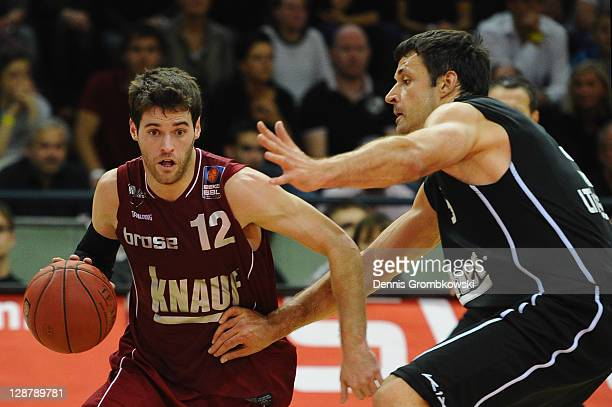Ben Jacobsen of Wuerzburg and Elvir Ovcina of Giessen battle for the ball during the Beko BBL Bundesliga match between LTi Giessen 46ers and s Oliver...