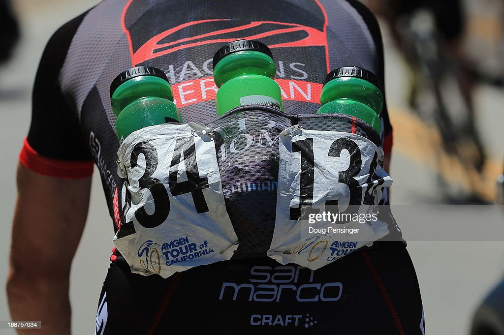 Ben Jacques-Maynes of the USA riding for Jamis-Hagens Berman collects water bottles from the team car to deliver to his teammates including overall race leader Janier Acevedo of Columbia during Stage Three of the 2013 Amgen Tour of California from Palmdale to Santa Clarita on May 14, 2013 in Santa Clarita, California.