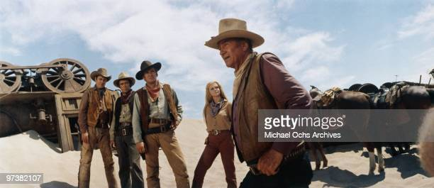Ben Johnson Christopher George Rod Taylor AnnMargret and John Wayne on the set of 'The Train Robbers' directed by Burt Kennedy in 1973 in Durango...