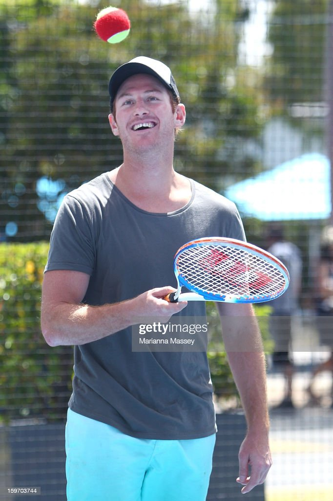 Ben Johnson from Collingwood Football Club practices on the mini tennis court with the MLC Hotshots during day five of the 2013 Australian Open at Melbourne Park on January 19, 2013 in Melbourne, Australia.