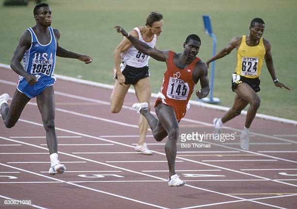 Ben Johnson of Canada crosses the line in the men's 100 metre final to take the gold medal slashing a tenth of a second off the World Record in 983...