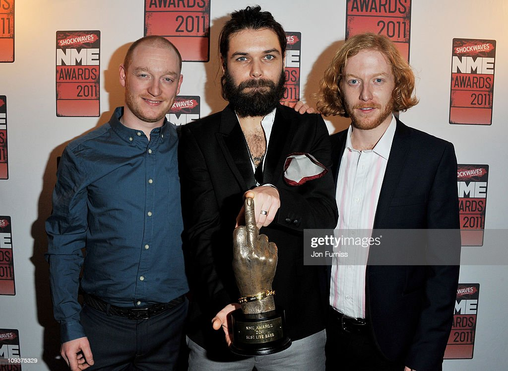 Ben Johnston , Simon Neil and James Johnston of Biffy Clyro pose with the award for 'Best Live Band' during the NME Awards 2011 at Brixton Academy on February 23, 2011 in London, England.
