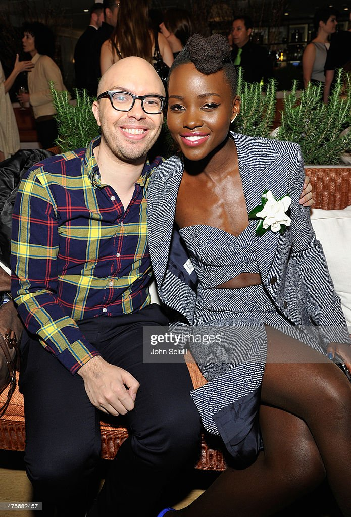 Ben Kahn (L) and Actress <a gi-track='captionPersonalityLinkClicked' href=/galleries/search?phrase=Lupita+Nyong%27o&family=editorial&specificpeople=10961876 ng-click='$event.stopPropagation()'>Lupita Nyong'o</a> attend the Women In Film Pre-Oscar Cocktail Party presented by Perrier-Jouet, MAC Cosmetics & MaxMara at Fig & Olive Melrose Place on February 28, 2014 in West Hollywood, California.