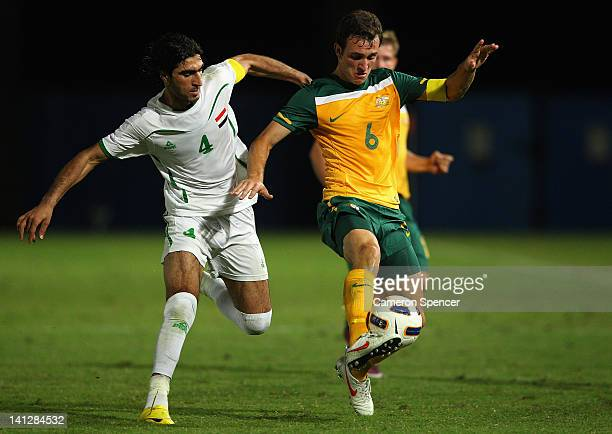 Ben Kantarovski of Australia contests the ball with Ahmed Ibrahim Khalaf of Iraq during the third round 2012 Olympic Games Asian Qualifier match...