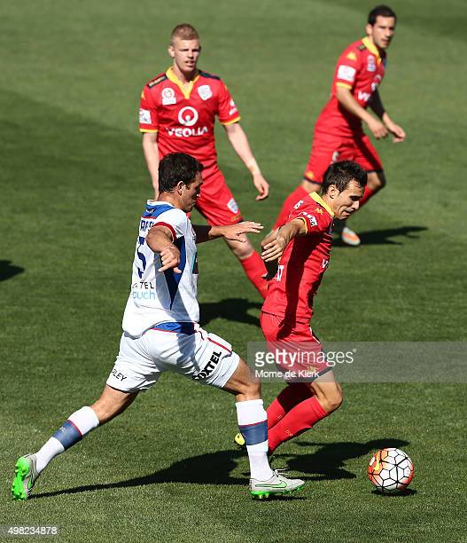 Ben Kantarovski of Newcastle Jets competes for the ball with Isaas of Adelaide United during the round seven ALeague match between Adelaide United...