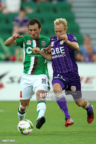 Ben Kantarovski of the Jets and Mitch Nichols of the Glory contest for the ball during the round four ALeague match between Perth Glory and the...