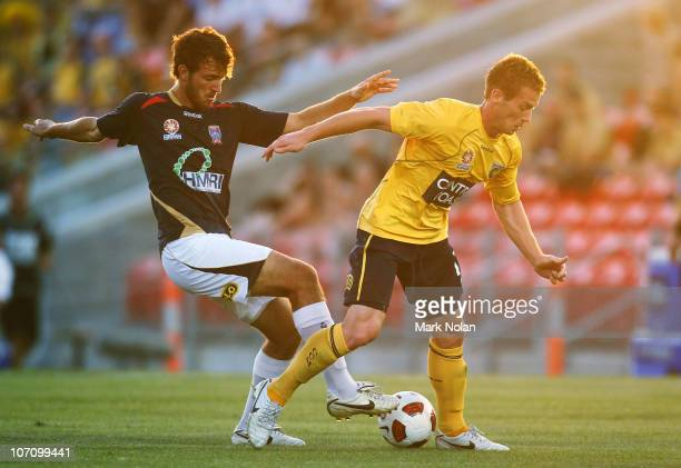 Ben Kantarovski of the Jets and Oliver Bozanic of the Mariners contest possession during the round 16 ALeague match between the Newcastle Jets and...