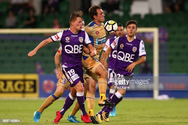 Ben Kantarovski of the Jets contests for the ball against Joseph Knowles and Jacob Italiano of the Glory during the round 10 ALeague match between...