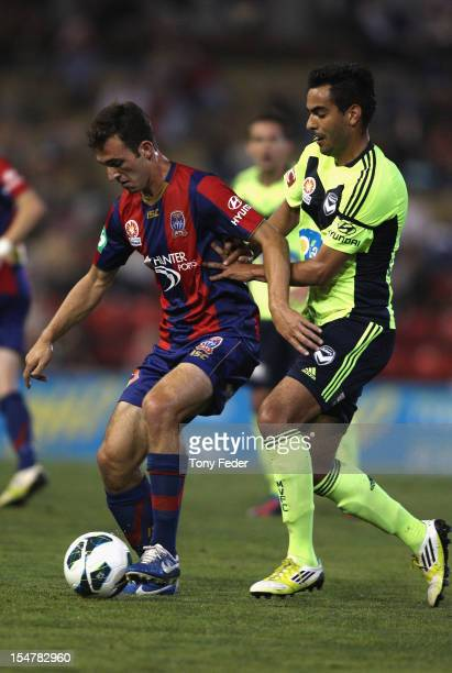 Ben Kantarovski of the Jets holds off his opponent during the round four ALeague match between the Newcastle Jets and the Melbourne Victory at Hunter...