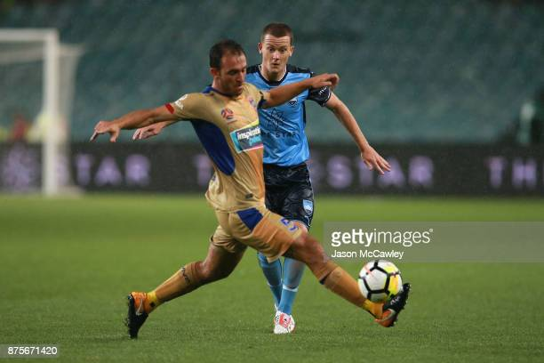 Ben Kantarovski of the Jets is challenged by Brandon O'Neill of Sydney during the round seven ALeague match between Sydney FC and Newcastle Jets at...