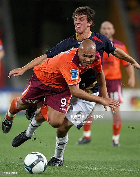 Ben Kantarovski of the Jets is penalised for this tackle on Sergio Van Dijk of the Roar during the round 13 ALeague match between the Brisbane Roar...