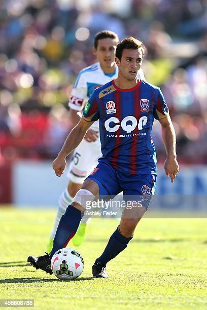 Ben Kantarovski of the Jets is tackled by Mark Milligan of the Victory defence during the round five ALeague match between Newcastle Jets and...