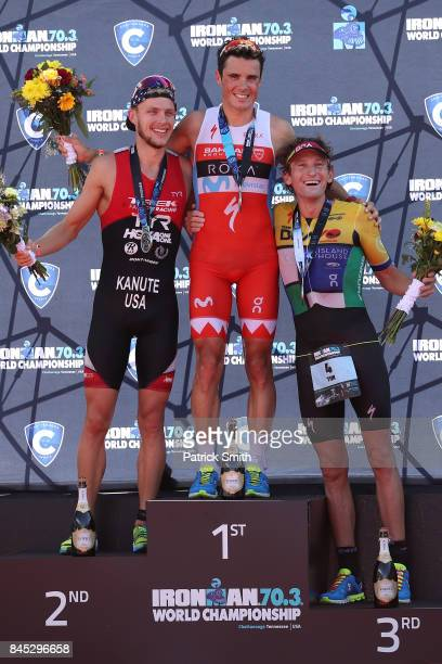 Ben Kanute of the USA Javier Gomez of Spain and Tim Don of Great Britain celebrate on the podium after the IRONMAN 703 Men's World Championship on...