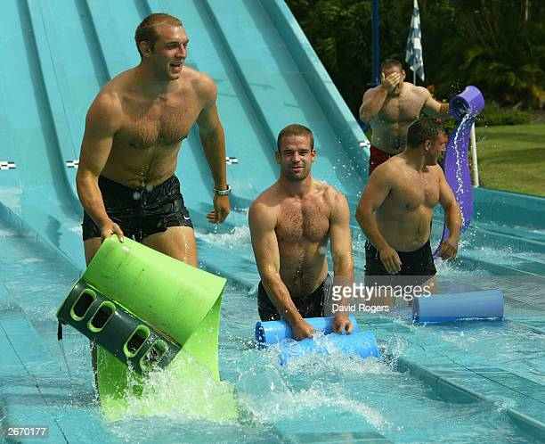 Ben Kay Joe Worsley Julian White and Trevor Woodman of England enjoy the waterslide at the Wet 'n' Wild theme park October 28 2003 the Gold Coast...