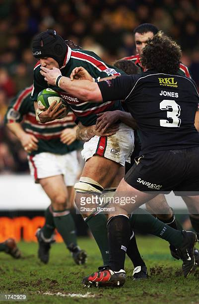 Ben Kay of Leicester Tigers barges past Adam Jones of Neath during the Heineken Cup Pool 1 match held on January 18 2003 at Welford Road Stadium in...