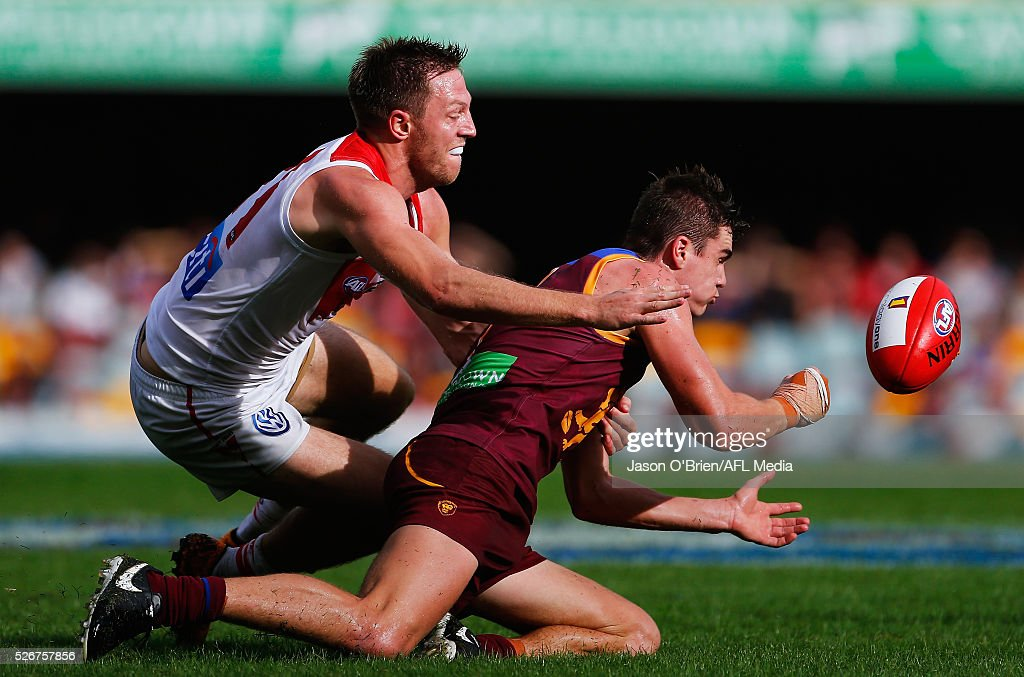 Ben Keays of the Lions gets a handpass away during the round six AFL match between the Brisbane Lions and the Sydney Swans at The Gabba on May 1, 2016 in Brisbane, Australia.